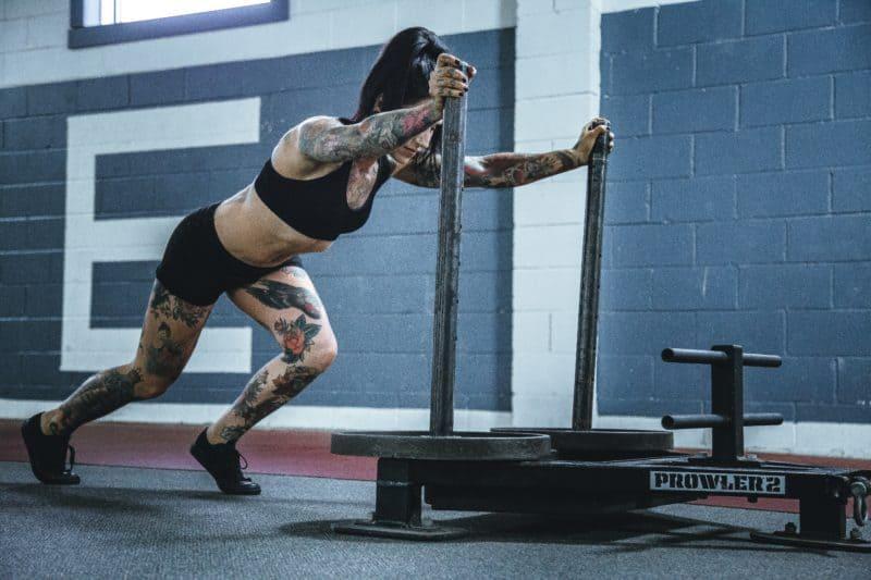 woman pushing weights