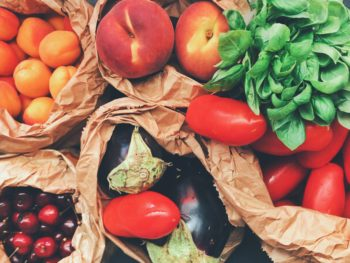 Fruits and vegetables in paper bags